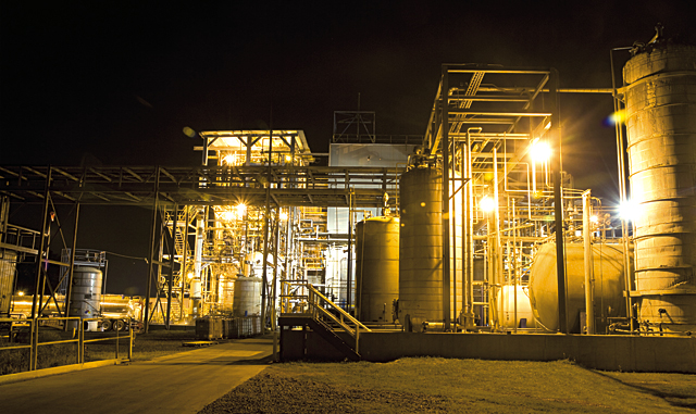 InChem's large plant glows in the night as it manufactures chemical round the clock